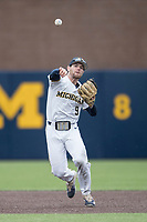 Michigan Wolverines shortstop Michael Brdar (9) makes a throw to first base against the Michigan State Spartans on May 19, 2017 at Ray Fisher Stadium in Ann Arbor, Michigan. Michigan defeated Michigan State 11-6. (Andrew Woolley/Four Seam Images)
