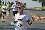 Photo by Phil Grout..With a helping hand of encouragement from a bystander, Britney Forman breaks from the pack and heads toward the finish line of the Army Birthday 5K run at Fort Meade.