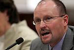 Nevada Public Employees' Benefits Program Director Jim Wells testifies at the Legislature in Carson City, Nev. on Wednesday, Feb. 23, 2011..Photo by Cathleen Allison
