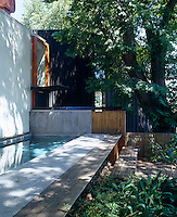 The lap pool in the garden is surrounded by several ancient elm trees that provide welcome shade