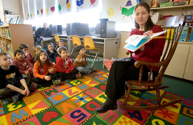 WOODBURY CT. 28 February 2014-022814SV07-Bonnie Knapik, Woodbury Library Children&rsquo;s Librarian, reads to students at Mitchell Elementary School in Middlebury Friday. Local people were reading Dr. Seuss books to the students.<br /> Steven Valenti Republican-American