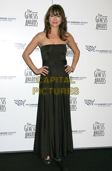LINDA CARDELLINI.22nd Annual Genesis Awards held at the Beverly Hilton Hotel,  Beverly Hills, California, USA,  29 March 2008..full length hands on hips black maxi dress strapless .CAP/ADM/RE.©Russ Elliot/Admedia/Capital PIctures