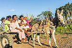 "Group of Wayuu indigenous women traveling on a mule cart outside a ""rancheria"", or traditional rural settlement, in La Guajira, Colombia."