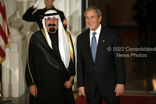 Washington, DC - November 14, 2008 -- United States President George W. Bush greets King Abdullah Bin Abdulaziz of Saudi Arabia to the White House for a working dinner at the start of the G20 Summit on Financial Markets and the World Economy. .Credit: Gary Fabiano - Pool via CNP