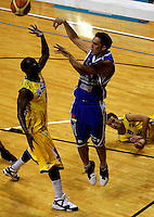 Matt Te Huna passes under pressure from Otago's Lemar Gayle during the NBL Basketball match between Wellington Saints and Otago Nuggets at TSB Bank Arena, Wellington, New Zealand on Sunday, 30 March 2008. Photo: Dave Lintott / lintottphoto.co.nz
