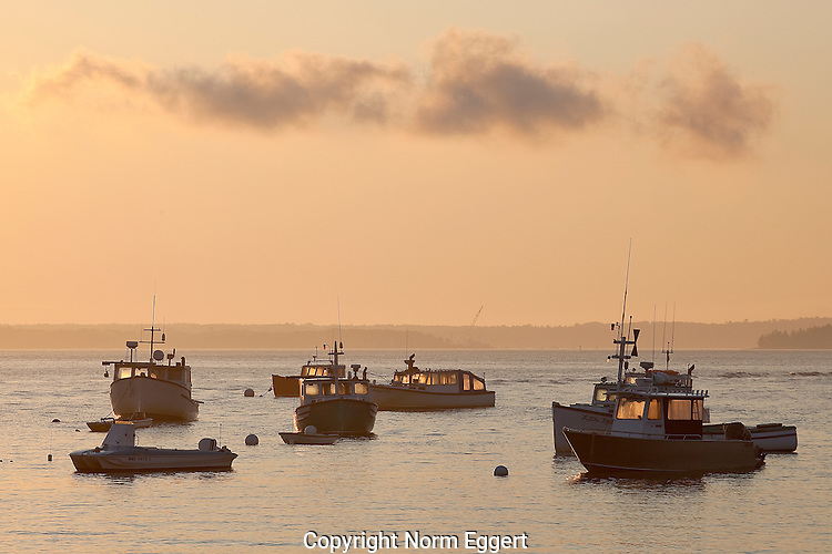 Early Morning at Lincolnville Harbor, Maine. Early morning light reflected in the fishing boat's windows.