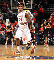 Dec. 22, 2010; Charlottesville, VA, USA; Virginia Cavaliers guard K.T. Harrell (24) reacts to a play during the game against the Seattle Redhawks at the John Paul Jones Arena. Mandatory Credit: Andrew Shurtleff