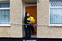 Pictured: A police forensics officer exits the house in Aberdare. Tuesday 19 December 2017<br /> Re: Natasha Jex (also known as Natasha Smith) has killed her husband Neil Jex (also known as Neal Jex) at their house in Aberdare, Wales, UK.