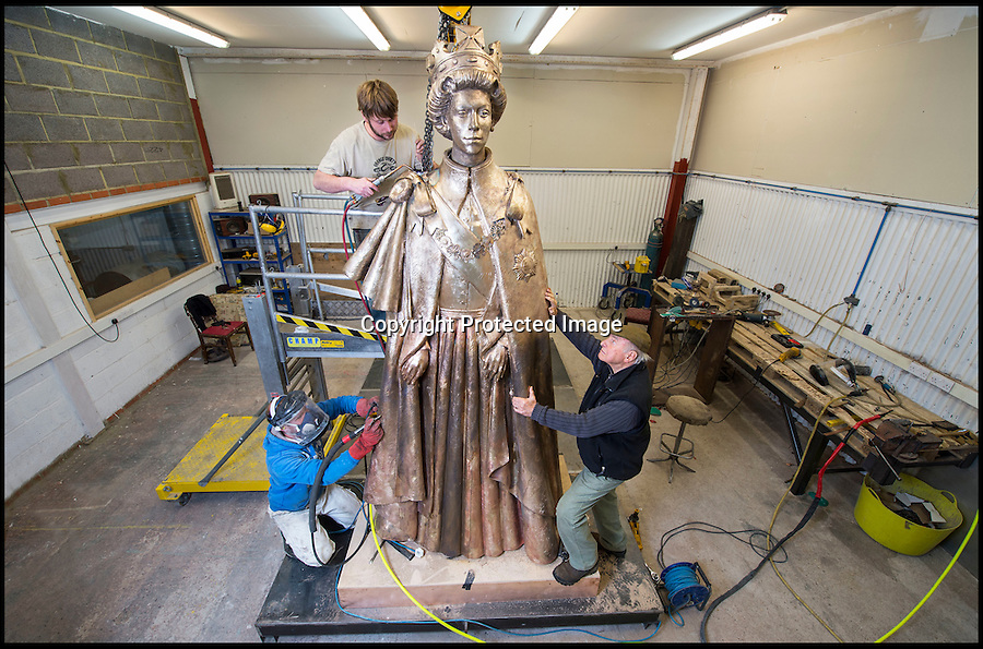BNPS.co.uk (01202 558833)<br /> Pic: PhilYeomans/BNPS<br /> <br /> First sight...<br /> <br /> A huge statue of Queen Elizabeth II is being finished off at Lockbund Foundry near Banbury in Oxfordshire - before its unveiling at Runnymede to celebrate the 800th anniversary of Magna Carta.<br /> <br /> At over twice life size the imposing bronze sculpture by James Butler will dominate the historic meadow where the divine right of Kings was first checked.<br /> <br /> It shows the Queen in full Garter Robes and has been inspired by the 1954 portraits by Pietro Annigoni. The 4m (13ft) bronze sculpture will be unveiled on 14 June.