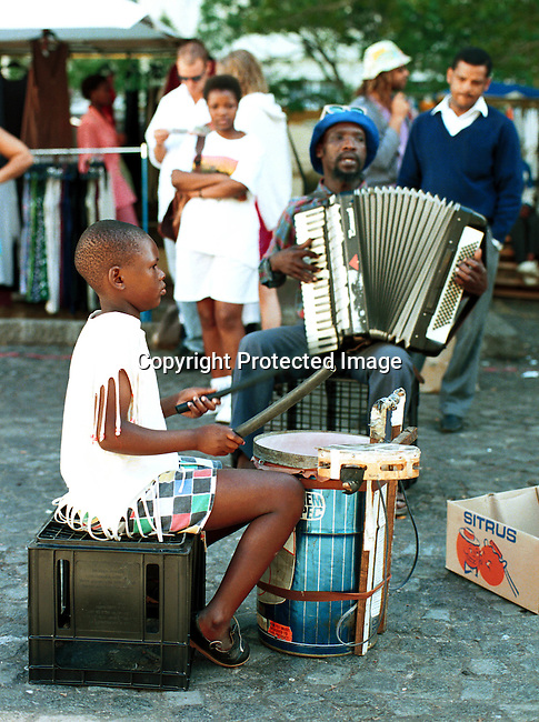 dimudru00009 Drum. Street musicians playing in Adderly street, a main shopping street in the center of Cape Town, South Africa. Accordian..©Per-Anders Pettersson/iAfrika Photos