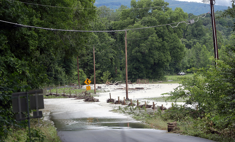 Flood waters from the South River ravage a large section of South River Road Friday in Greene County. Photo/Andrew Shurtleff Photography, LLC