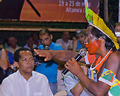 "Altamira, Brazil. ""Xingu Vivo Para Sempre"" protest meeting about the proposed Belo Monte hydroeletric dam and other dams on the Xingu river and its tributaries. Public Prosecutor Marco Antonio hearing a Kayapo protest."
