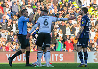 Referee Craig Pawson shows Leeds United's Mateusz Klich the yellow card<br /> <br /> Photographer Alex Dodd/CameraSport<br /> <br /> The EFL Sky Bet Championship Play-off  First Leg - Derby County v Leeds United - Thursday 9th May 2019 - Pride Park - Derby<br /> <br /> World Copyright © 2019 CameraSport. All rights reserved. 43 Linden Ave. Countesthorpe. Leicester. England. LE8 5PG - Tel: +44 (0) 116 277 4147 - admin@camerasport.com - www.camerasport.com