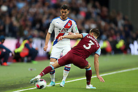 Joel Ward of Crystal Palace and Aaron Cresswell of West Ham United during West Ham United vs Crystal Palace, Premier League Football at The London Stadium on 5th October 2019