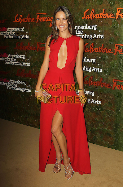 Alessandra Ambrosio<br /> Wallis Annenberg Center For The Performing Arts Inaugural Gala held at Wallis Annenberg Center For The Performing Arts,  Beverly Hills, California, USA, 17th October 2013.<br /> full length red dress long maxi sleeveless cut out slit split  gold clutch bag strappy sandals shoes <br /> CAP/ADM/KB<br /> &copy;Kevan Brooks/AdMedia/Capital Pictures