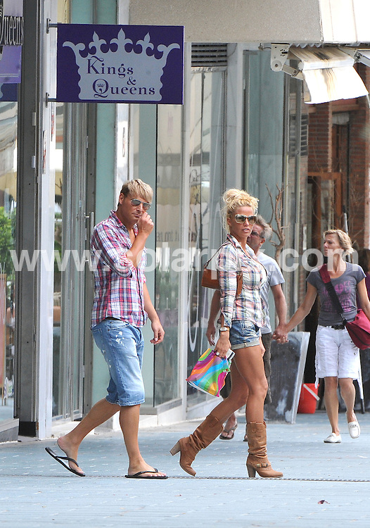 **ALL ROUND EXCLUSIVE PICTURES FROM SOLARPIX.COM**   .**WORLDWIDE SYNDICATION RIGHTS**  .**MINIMUM UK MAGAZINE PUBLICATION FEE £250.00 PER PICTURE**                                                                                             Katie Price and Argentinian boyfriend Leandro Penna took off to the shops in Puerto Banus, in Marbella this afternoon and made the most of the bad Spanish weather. Katie looked fantastic in little cut off denim shorts while Leandro sported a pair of bright blue trousers and trainers.                                                                  .This pic:      Katie Price & Gary Cockerill                                                                                    JOB REF:    13484   AB1/SF      DATE:     02.06.11                                                       **MUST CREDIT SOLARPIX.COM OR DOUBLE FEE WILL BE CHARGED**                                                                      **MUST AGREE FEE BEFORE ONLINE USAGE**                               **CALL US ON: +34 952 811 768 or LOW RATE FROM UK 0844 617 7637**
