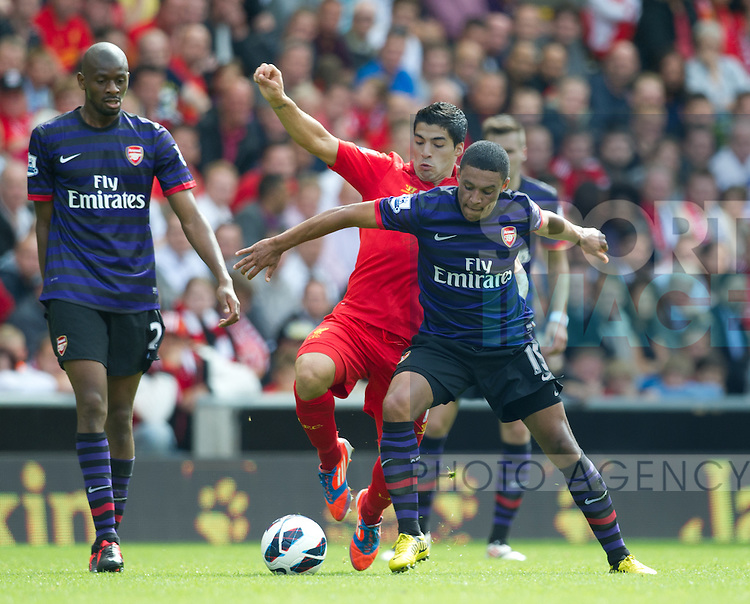 Football - Liverpool v Arsenal - Barclays Premier League - Anfield Stadium - Season 12/13 - 2/9/12 .Luis Suarez of Liverpool challenges Alex Oxlade-Chamberlain of Arsenal.Mandatory Credit: Simon Bellis/Sportimage.EDITORIAL USE ONLY. No use with unaurthorized audio, video, data, fixture lists, club/league logos or ?live? services. Online in-match use limited to 45 images, no video emulation. No use in betting, games or single club/league/player publications. Please contact your account representative for further details...