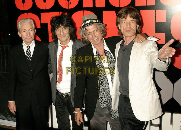 """THE ROLLING STONES - CHARLIE WATTS, RONNIE WOOD, KEITH RICHARDS & MICK JAGGER .New York Premiere of """"Shine A Light"""" at the Ziegfeld Theater, New York, NY, USA..March 30th, 2008.half length black white grey gray pinstripe suit jacket hat hand leopard print scarf .CAP/LNC/TOM.©TOM/LNC/Capital Pictures."""