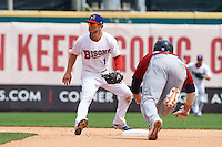 Buffalo Bisons shortstop Jonathan Diaz (1) waits for a throw as Tyler Holt (15) steals second during a game against the Columbus Clippers on July 19, 2015 at Coca-Cola Field in Buffalo, New York.  Buffalo defeated Columbus 4-3 in twelve innings.  (Mike Janes/Four Seam Images)