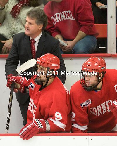 Mike Schafer (Cornell - Head Coach), Tyler Roeszler (Cornell - 9), Joe Devin (Cornell - 22) - The visiting Cornell University Big Red defeated the Harvard University Crimson 2-1 on Saturday, January 29, 2011, at Bright Hockey Center in Cambridge, Massachusetts.