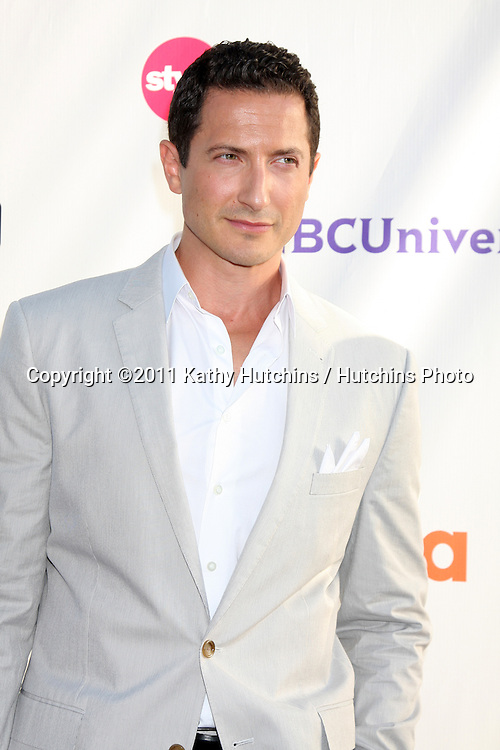 LOS ANGELES - AUG 1:  Sasha Roiz arriving at the NBC TCA Summer 2011 All Star Party at SLS Hotel on August 1, 2011 in Los Angeles, CA