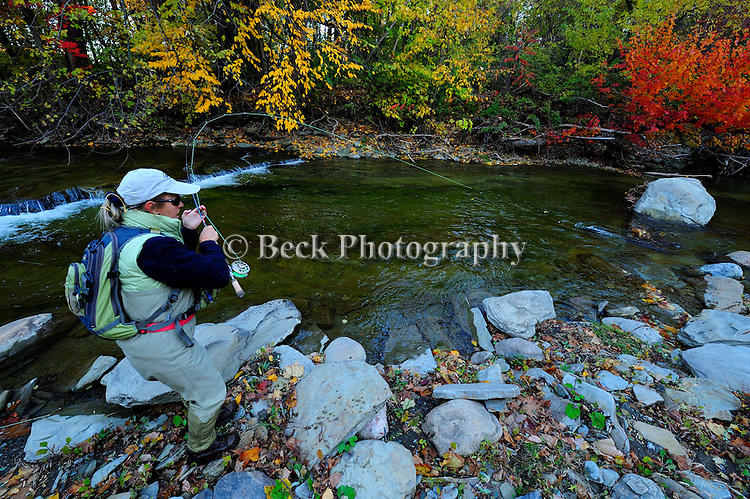 WOMAN FLY FISHING FOR STEELHEAD IN ERIE