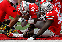 Ohio State Buckeyes quarterback J.T. Barrett (16) scores a touchdown in the first half of their game at Ohio Stadium in Columbus, Ohio on October 7, 2017.   [Brooke LaValley / Dispatch]
