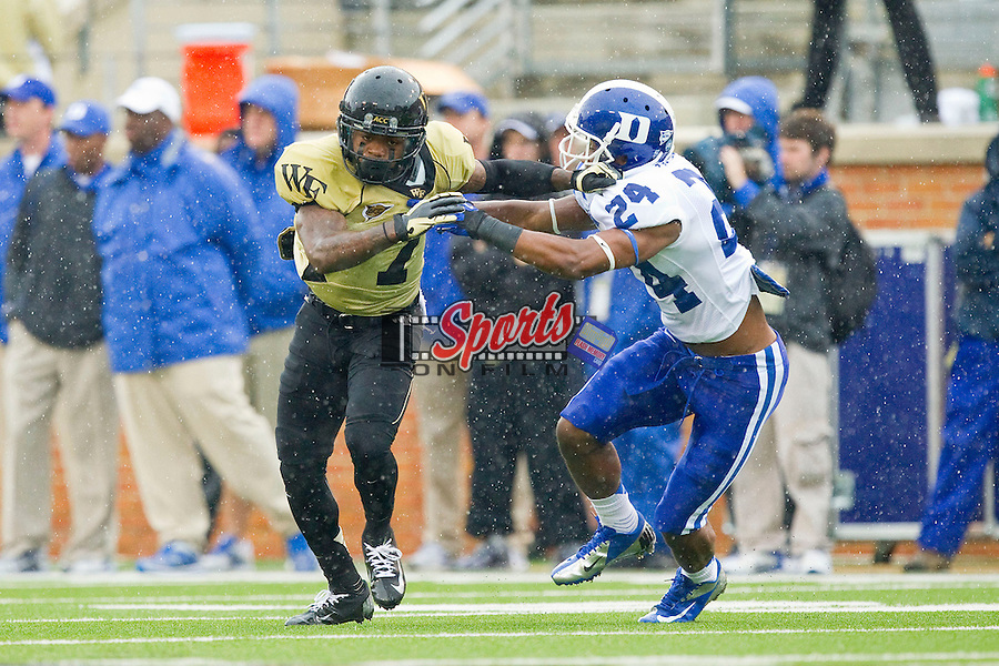 Merrill Noel (7) of the Wake Forest Demon Deacons tries to break free from Garett Patterson (24) of the Duke Blue Devils on punt coverage at BB&T Field on September 29, 2012 in Winston-Salem, North Carolina.  The Blue Devils defeated the Demon Deacons 34-27.  (Brian Westerholt/Sports On Film)