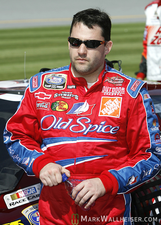 Tony Stewart stand next to his number 33 Old Spice Chevrolet that he won the Hershey's Kissables 300 Bush Series race in at Daytona international Speedway February 18, 2006 in Daytona, Florida.