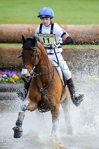 05.05.2013 Badminton, England. Francis Whittington on Sir Percival III tackles 'The Lake' water jump during the Cross Country Test of the Mitsubishi Motors Badminton Horse Trials 2013 in the grounds of Badminton House.