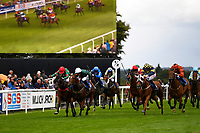 Red Dragon (orange right) ridden by Rob Hornby and trained by Michael Blanshard makes a run to win the   Dartmouth General Contractors Ltd Handicap (Div 1), during Afternoon Racing at Salisbury Racecourse on 7th August 2017