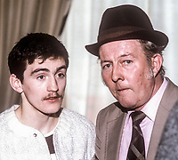 Professional Irish boxer, Barry McGuigan, with Davy &ldquo;The Hat&rdquo; Donnelly, a member of the Barney Eastwood promotion team, October, 1982, 198210000260BMG+BD<br /><br />Copyright Image from Victor Patterson, 54 Dorchester Park, <br />Belfast, UK, BT9 6RJ<br /><br />t1: +44 28 9066 1296 (from Rep of Ireland 048 9066 1296)<br />t2: +44 28 9002 2446 (from Rep of Ireland 048 9002 2446)<br />m: +44 7802 353836<br /><br />victorpatterson@me.com<br />www.victorpatterson.com<br /><br />Please see my Terms and Conditions of Use at VICTORPATTERSON.COM. It is IMPORTANT that you familiarise yourself with them.<br /><br />Images used on the Internet must be visibly watermarked i.e. &copy;VICTORPATTERSON.COM within the body of the image and copyright metadata must not be deleted. Images used on the Internet have a size restriction of 4kbs and are chargeable at the then current NUJ rates.<br /><br />This image is only available for the use of the download recipient i.e. television station, newspaper, magazine, book publisher, etc, and must not be passed on to any third party. It is also downloaded on condition that each and every usage is notified within 7 days to victorpatterson@me.com<br /><br />The right of Victor Patterson to be identified as the author is asserted in accordance with The Copyright Designs And Patents Act (1988).