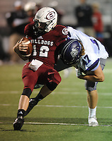 NWA Democrat-Gazette/ANDY SHUPE<br /> Eli Hale (47) of Fayetteville sacks Jack Lindsey (12) of Springdale Friday, Oct. 9, 2015, during the first half of play at Jarrell Williams Bulldog Stadium in Springdale. Visit nwadg.com/photos to see more photographs from the game.