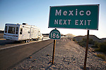 RV on highway near Mexico exit sign, Andrade, California.
