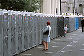 A woman waits outside portable toilets in Pall Mall, central London.