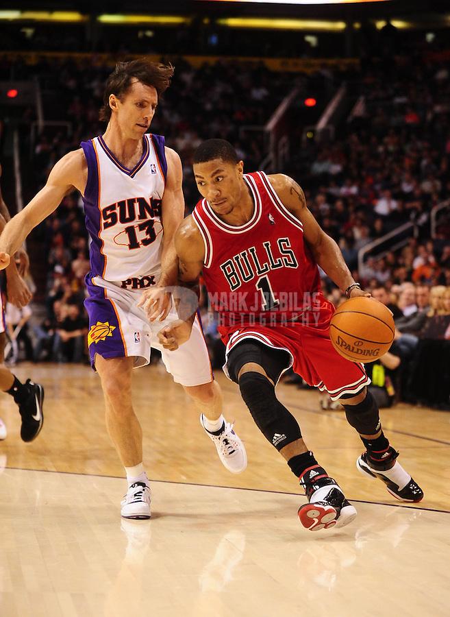 Jan. 22, 2010; Phoenix, AZ, USA; Chicago Bulls guard (1) Derrick Rose drives to the basket past Phoenix Suns guard (13) Steve Nash at the US Airways Center. Chicago defeated Phoenix 115-104. Mandatory Credit: Mark J. Rebilas-