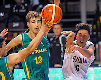 Action from the FIBA Oceania Under-16 tournament final between New Zealand (white) and Australia (green) at TSB Bank Arena, Wellington, New Zealand on Tuesday, 18 August 2015. Photo: Dave Lintott / lintottphoto.co.nz