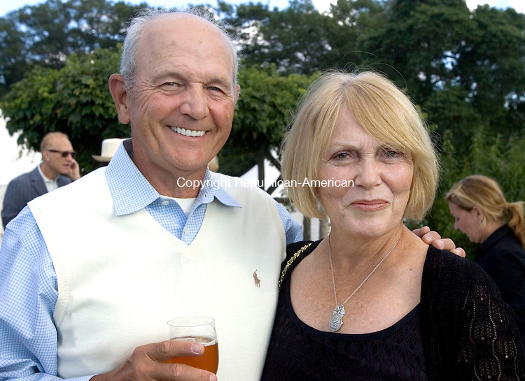 MIDDLEBURY CT. 24 August 2014-082414SV15-Dennis and Sue Healy of Middlebury attend a sunset garden party at the Whittemore estate in Middlebury Sunday. The event was for The Mattatuck Museum.<br /> Steven Valenti Republican-American