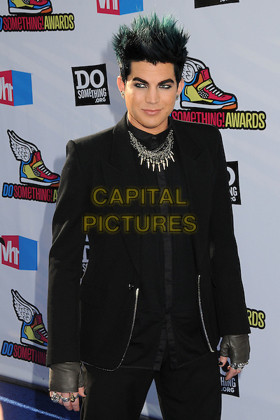 Adam Lambert.The 2011 Do Something Awards held at The Palladium in Hollywood, California, USA..August 14th, 2011.half length black green dyed hair suit fingerless gloves necklace .CAP/ADM/BP.©Byron Purvis/AdMedia/Capital Pictures.