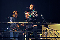 LONDON, ENGLAND - APRIL 12: Tim Kingsbury and Win Butler of 'Arcade Fire' performing at SSE Arena on April 12, 2018 in London, England.<br /> CAP/MAR<br /> &copy;MAR/Capital Pictures