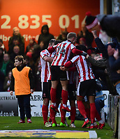 Lincoln City's Lee Frecklington (hidden) celebrates scoring his sides equalising goal to make the score 1-1<br /> <br /> Photographer Chris Vaughan/CameraSport<br /> <br /> The EFL Sky Bet League Two - Lincoln City v Notts County - Saturday 13th January 2018 - Sincil Bank - Lincoln<br /> <br /> World Copyright &copy; 2018 CameraSport. All rights reserved. 43 Linden Ave. Countesthorpe. Leicester. England. LE8 5PG - Tel: +44 (0) 116 277 4147 - admin@camerasport.com - www.camerasport.com