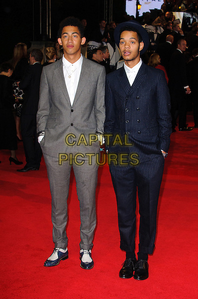 "Rizzle Kicks.Royal World Premiere of 'Skyfall' held at the Royal Albert Hall, London, England..October 23rd, 2012.full length white blue grey gray shirt suit hands in pockets band group Jordan ""Rizzle"" Stephens, Harley ""Sylvester"" Alexander-Sule.CAP/CJ.©Chris Joseph/Capital Pictures."