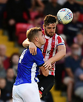 Lincoln City's Luke Waterfall vies for possession with Sheffield Wednesday's Joost Van Aken<br /> <br /> Photographer Chris Vaughan/CameraSport<br /> <br /> Football Pre-Season Friendly - Lincoln City v Sheffield Wednesday - Friday 13th July 2018 - Sincil Bank - Lincoln<br /> <br /> World Copyright &copy; 2018 CameraSport. All rights reserved. 43 Linden Ave. Countesthorpe. Leicester. England. LE8 5PG - Tel: +44 (0) 116 277 4147 - admin@camerasport.com - www.camerasport.com