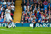 Sun 22 September 2013<br /> <br /> Pictured:Jonjo Shelvey of Swansea ties to get the ball around Danny Gabbidon of Crystal Palace<br /> <br /> Re: Barclays Premier League Crystal Palace FC  v Swansea City FC  at Selhurst Park, London