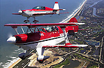 A pair of aerobatic competitors in a Pitts S2, foreground, and an Extra 300, background, fly over the beach above the Hammock Dunes development in Flagler County, Monday, March 11, 2002.  Numerous aerobatic competitors will be above the Flagler County Airport for this weekend's aerobatic competition put on by the Embry-Riddle Sport Aviation Club and the Daytona Beach chapter of the International Aerobatic Club..(Brian Myrick)