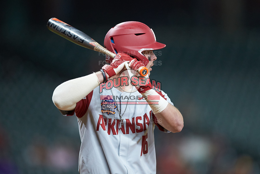 Cole Austin (16) of the Arkansas Razorbacks at bat against the Texas Longhorns in game six of the 2020 Shriners Hospitals for Children College Classic at Minute Maid Park on February 28, 2020 in Houston, Texas. The Longhorns defeated the Razorbacks 8-7. (Brian Westerholt/Four Seam Images)