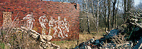 Mural of Russian soldiers on the wall of a former Russian army barracks from the Cold War era.. CHECK with MRM/FNA