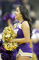 DEC 22, 2015:  Washington cheerleader Maggie Clarke entertained fans during a TV timeout in the game against Seattle University. Washington defeated Seattle University 79-68 at Alaska Airlines Arena in Seattle, WA.