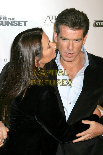 "PIERCE BROSNAN & KEELY SHAYE SMITH .""After The Sunset"" - New York Premiere - Arrivals, New York City, New York .November 9th, 2004.half length, married, husband, wife, arms around waist, hug, embrace, kiss, funny face.www.capitalpictures.com.sales@capitalpictures.com.© Capital Pictures."
