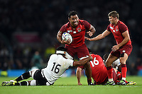 Billy Vunipola of England takes on the Fiji defence. Rugby World Cup Pool A match between England and Fiji on September 18, 2015 at Twickenham Stadium in London, England. Photo by: Patrick Khachfe / Onside Images